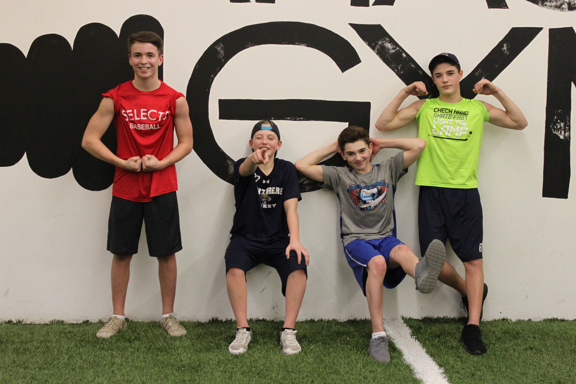 Youth and Teenage boys flexing for the camera at The Garage Gym in Amherstburg with a gym location in Kingsville as well.