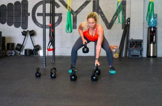 garage gym female working out